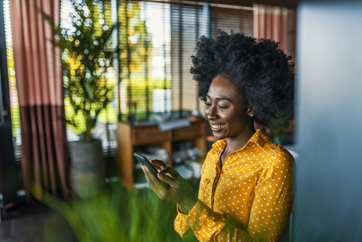 Woman checking email on mobile phone